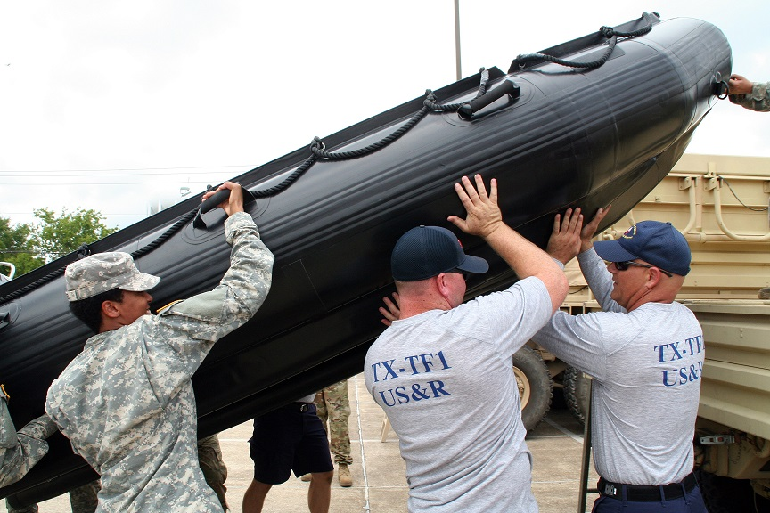 Texas Army National Guard Soldiers joined members of a Texas Task Force Ones Swift Water Rescue Team for<br /> interoperability training leading up to Hurricane Harvey, in Bryan, August 25, 2017.<br /> 700 members of the Texas Army National Guard are being mobilized as part of Hurricane Harvey response operations.<br /> (U.S. Army Photo by Sgt. Steve Johnson/Released)