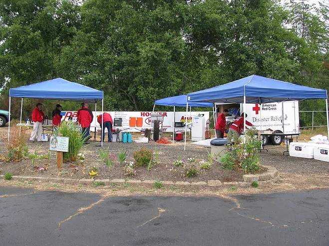 red cross team setting up onsite