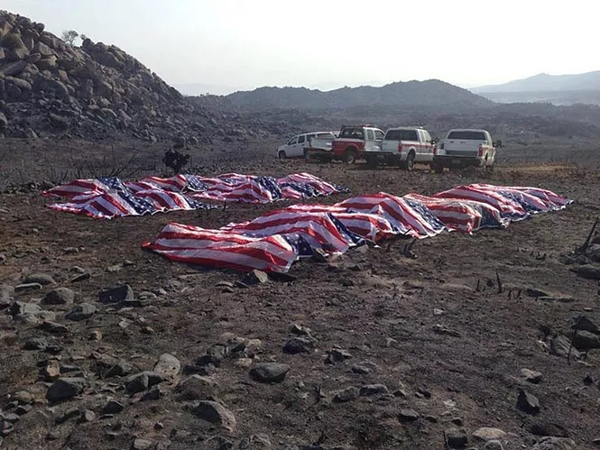 covered caskets of fallen yarnell hill firefighters